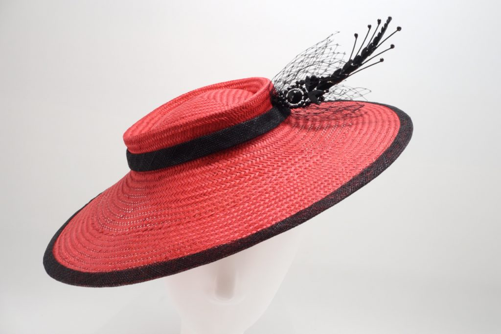 Red and black buntal hat by Sydney Milliner, Abigail Fergusson