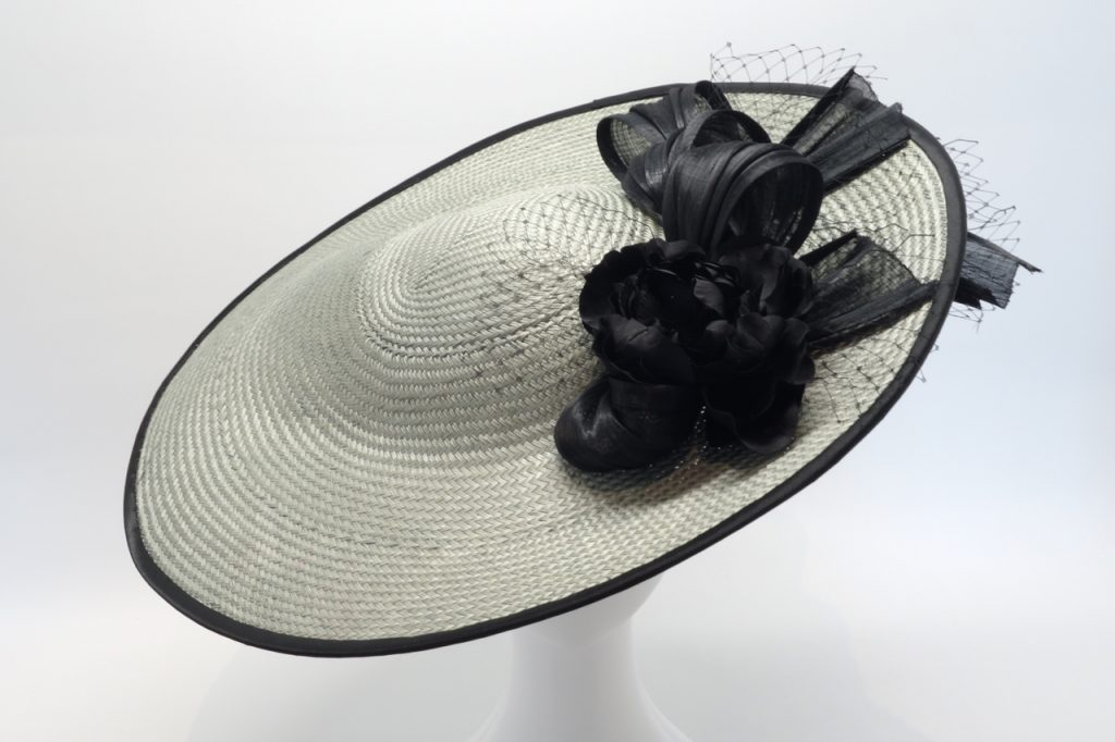 Grey saucer with black silk abaca loops and silk roses by Sydney Milliner, Abigail Fergusson Millinery
